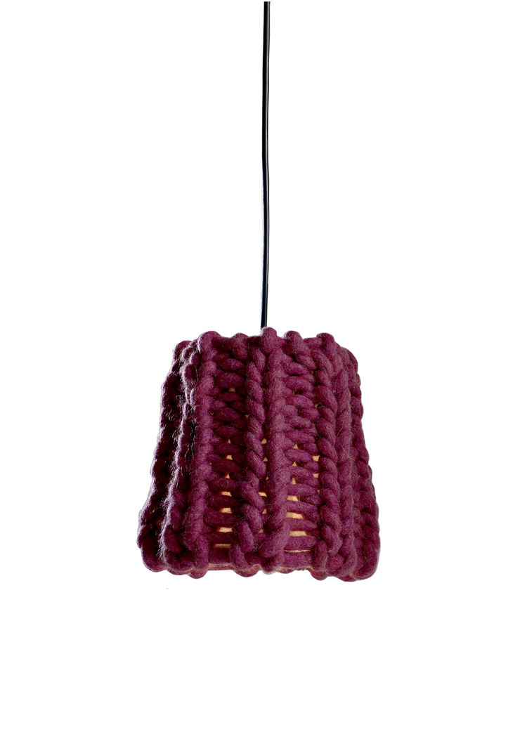 There were actually a handful of yarn lampshades at the fair—the others I saw were from Mut and Ana Krâs at the Salone Satellite—which, as a novice knitter and fan-of-craft, I loved. Granny, a chunky burgundy pendant by Pudelkern Design for Casamania, was
