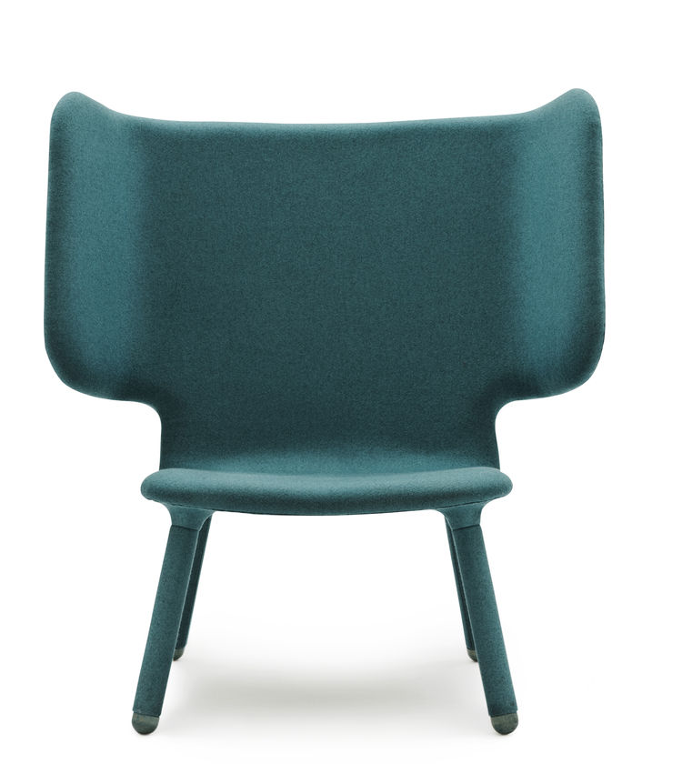 """The """"wings"""" on Valdemar, this new upholstered chair from industrial designers Martin Kechayas and Christian Nørgaard for Normann Copenhagen, make sitting into a blissfully solitary pleasure. The upholstery covers the legs, too, giving a complete color blo"""