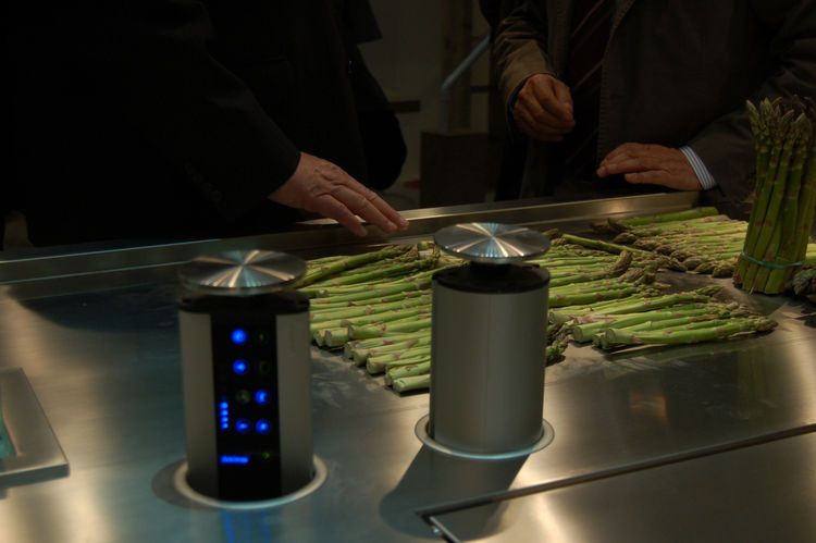 "At <a href=""http://www.arclinea.com/"">Arclinea</a>, the Convivium kitchen concept by Antonio Citterio features a built-in cooling tray (pictured here, keeping asparagus crisp), and temperature gauges that pop up from below."