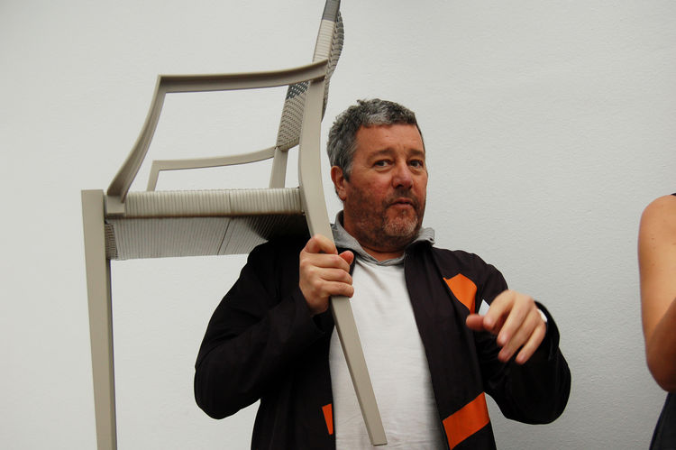 "Starck demonstrates the lightweight heft of his new outdoor chairs for <a href=http://www.dedon.de/en/home.html"">Dedon</a>. Look for Sam's interview with him soon."