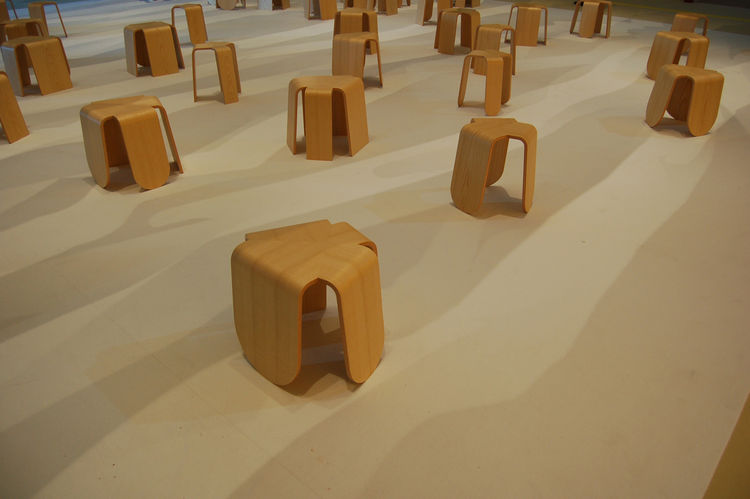 """Another public installation, this one created by Japanese design firm <a href=http://tonerico-inc.com/"""">Tonerico:Inc</a>, featured a sea of 49 bentwood stools, each representing a different country of Asia. The shadows on the floor were cast by huge panel"""