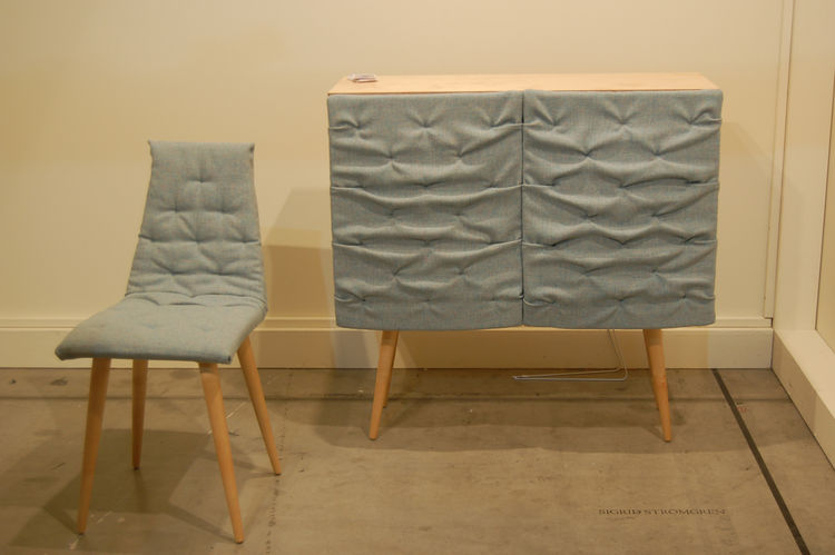 """The Eskimo Cabinet and Chair, by Swedish designer <a href=http://www.sigridstromgren.se/""""> Sigrid Strömgren</a>. The bunched fabric covering the cabinet """"doors"""" peels back to reveal shelving and is heavily padded in order to muffle sound."""