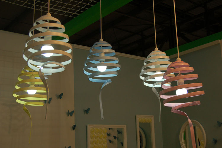 """I loved the sweet pastel hues of Swing, a bent-metal fixture by Japanese designer Atsushi Fujii of <a href=http://www.monochro.jp"""">Monochro Design Studio</a>. She, along with her partner Momoko Naito, presented work at Salone Satellite for the very first"""