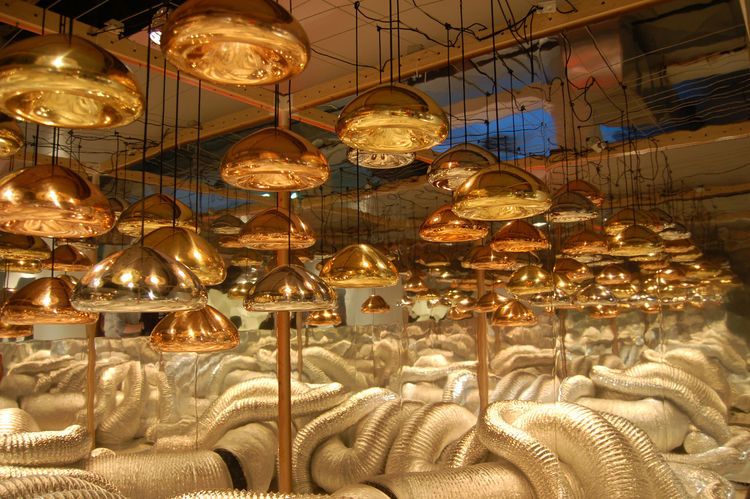 "A collection of silver, brass, and copper <a href=http://www.tomdixon.net/products/eu/void-light-copper"">Void Lamps</a> by Tom Dixon."