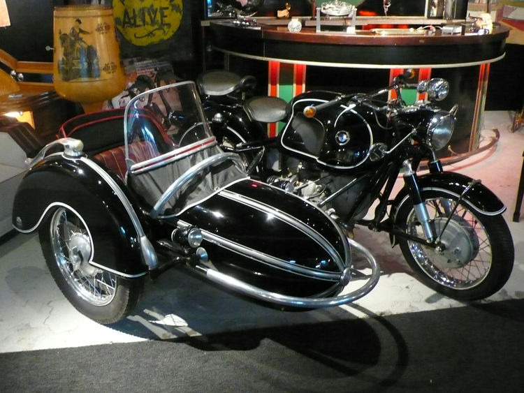 "A 1958 BMW motorcycle with a Steib sidecar, from the Steve McQueen motorcycle auction, at <a href=""http://www.offthewallantiques.com/"">Off the Wall Antiques</a>."