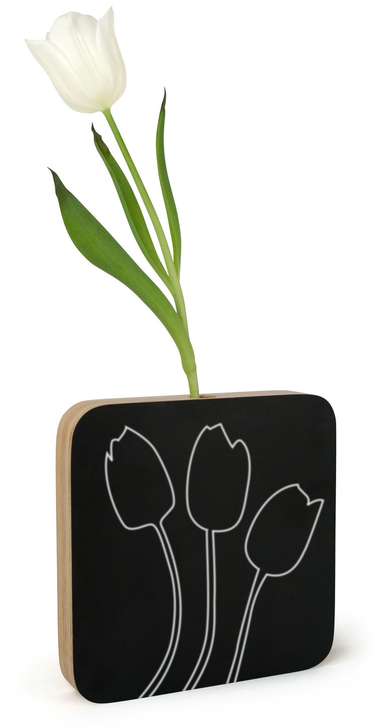 This dual-purpose design is both a single-stem vase and a mini chalkboard. The black surfaces can be used for messages or drawings, or left alone for a more sophisticated look. A small glass beaker sits in the top of the plywood block to hold the water fo