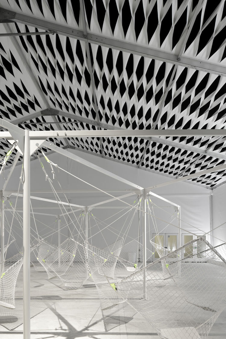 "The 24 seats fashioned from netting hang mid-air and are suspended by a metal frame. ""When we were shown [Grcic's] early renderings for Netscape, it was clear he understood the spirit of the space,"" says Granger."