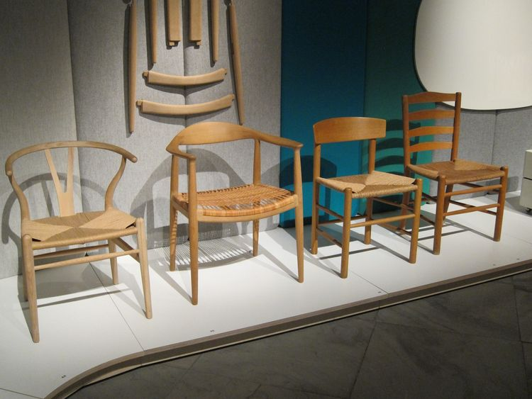 "A closer look at the quartet, which Olesen said showed an ""evolution of chairs."" The Round Chair (second from left) was ""the chair that made Danish design famous in the US,"" he said."