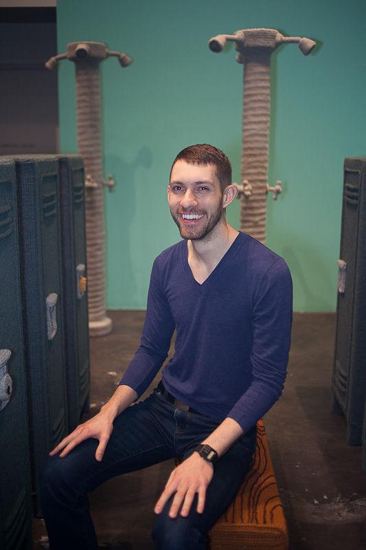 The artist sitting in his Locker Room.