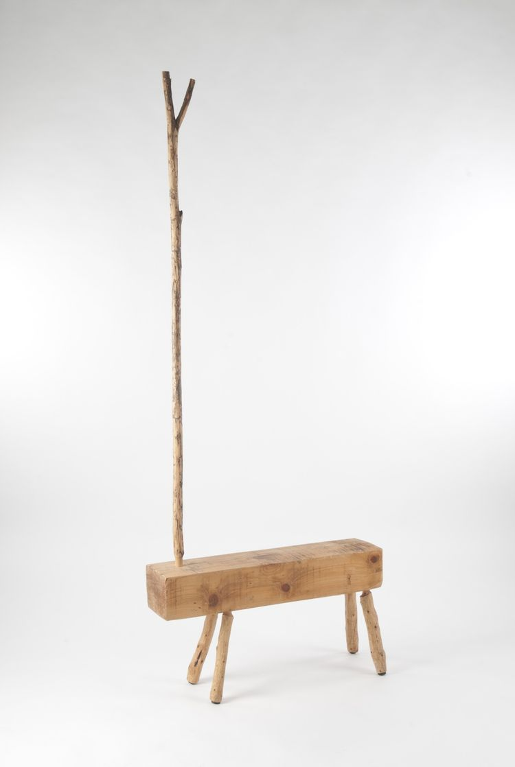 "<i>Raw 001</i> by Haim Parnas. ""The object is made of a white wood beam that was used by Israel Railway workers and then discarded. The legs of the piece and the mast are made of cypress branches found in the forest. The connector is a tree branch inserte"