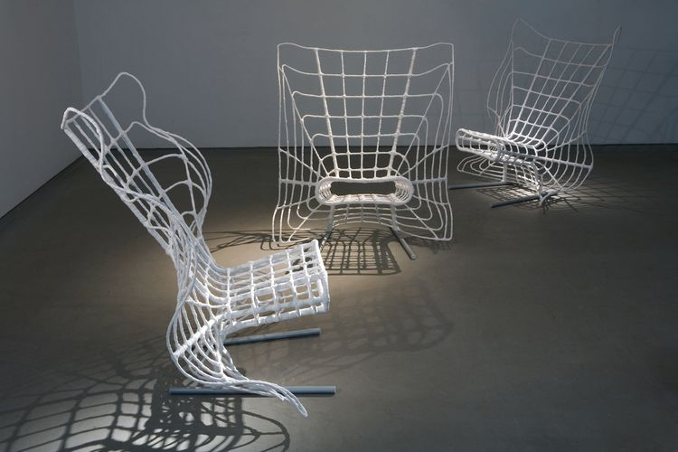 "<i>Mesh</i> by Tal Gur. ""Mesh is a web of metal wires that lie over a base of curved iron rods—a spider web of sorts. Polyurethane plastic bags have been twisted over the structure by heating and welding. The chair creates a sense of naturalness and organ"