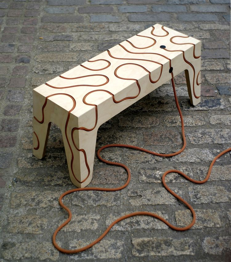 "<i>Rope Bench</i> by Yoav Reches. ""This plywood bench has been constructed using only rope tension. The system, which features the rope embedded directly in the plywood, can either lie flat or be realised into a complete seating unit."""
