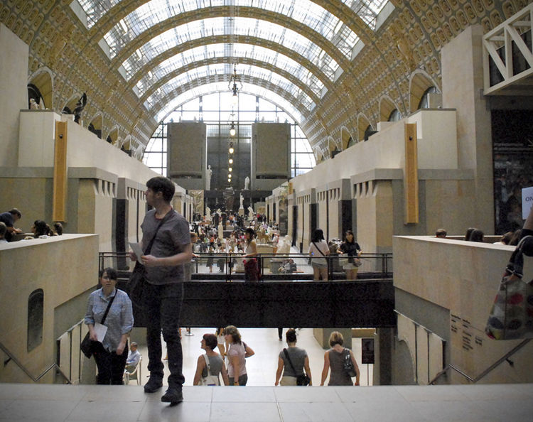 Perhaps the most striking aspect of the Musee d'Orsay is the spaciousness of its magnificent vaulted interior. The long central nave is punctuated by a series of bronze and stone sculptures, specifically six bronze 'allegorical sculptural groups' of the l