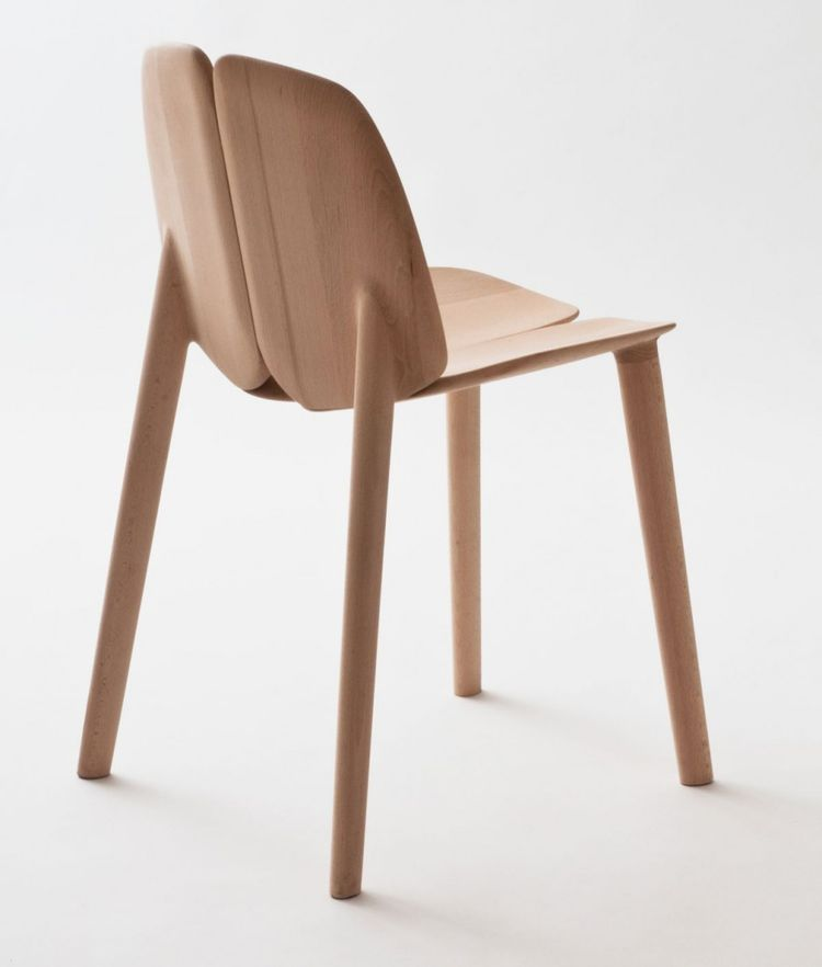 """A view of the completed chair, sculpted out of oak, maple, or ash using solar-powered, digitally controlled equipment. """"Chairs have the same properties they had hundreds of years ago, but technologies have lives and deaths,"""" Erwan reflected. """"Resetting te"""