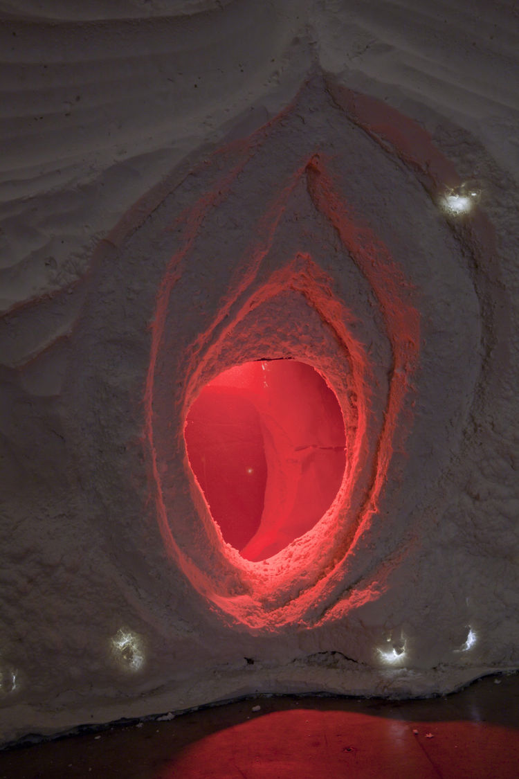 A glowing red orifice at the bottom of the parabolic chamber is inset with a mirror at the far end. Photo by Joshua White/Courtesy of SCI-Arc.