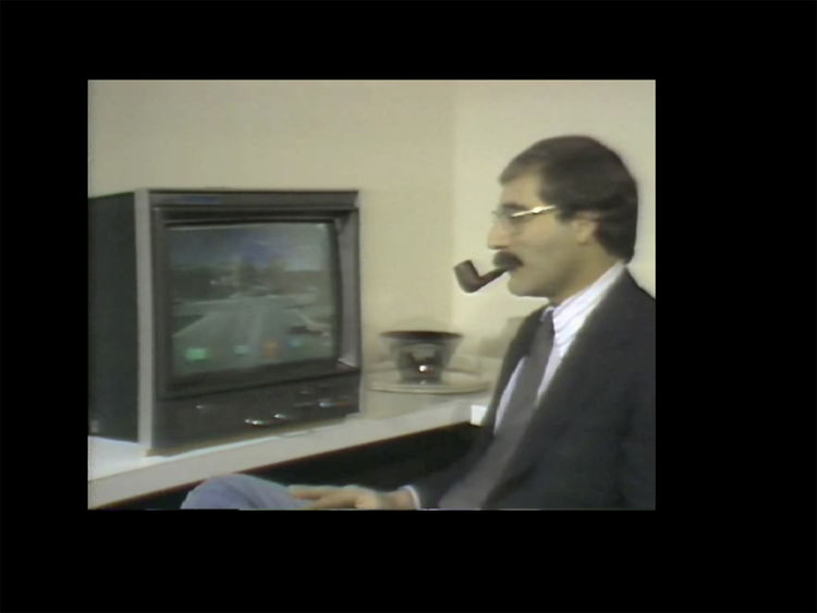 "(Film still from ""The Interactive Movie Map"") Your swank host introduces a ""hypermedia"" virtual tour."