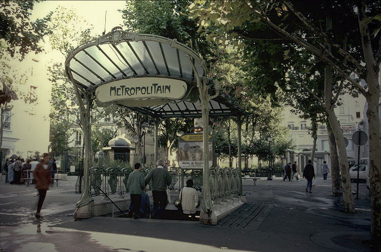 """Three stations today still boast Guimard's fan-shaped glass awnings, called édicules, as shown here at the Abbesses station in Montmartre. Photo courtesy of <a href=""""http://www.uncp.edu/home/rwb/Paris_Metro_Abesses.jpg>""""rwb</a>"""