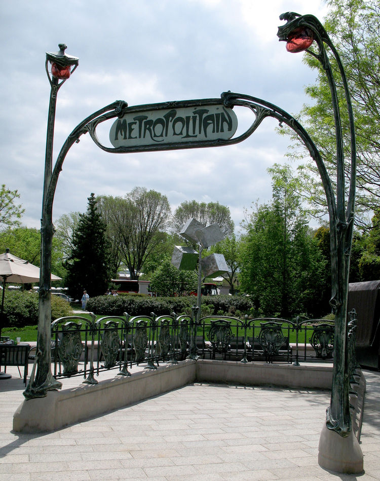 """No, this is not sign celebrating All Hallow's Eve. The Paris metro entrances were designed in 1900 by architect <a href=""""http://www.moma.org/collection/browse_results.php?object_id=2393""""> Hector Guimard</a>, who festooned them with cast iron gates and a d"""