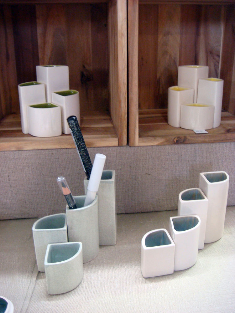 "This set of four ""Small to Tall"" containers from <a href=""http://jfishdesigns.com/"">JFish Designs</a> can be arranged in a couple different ways, which I thought was cool. They'd work as a stylish desk accessory or as bud vases. Either way, they're a stea"