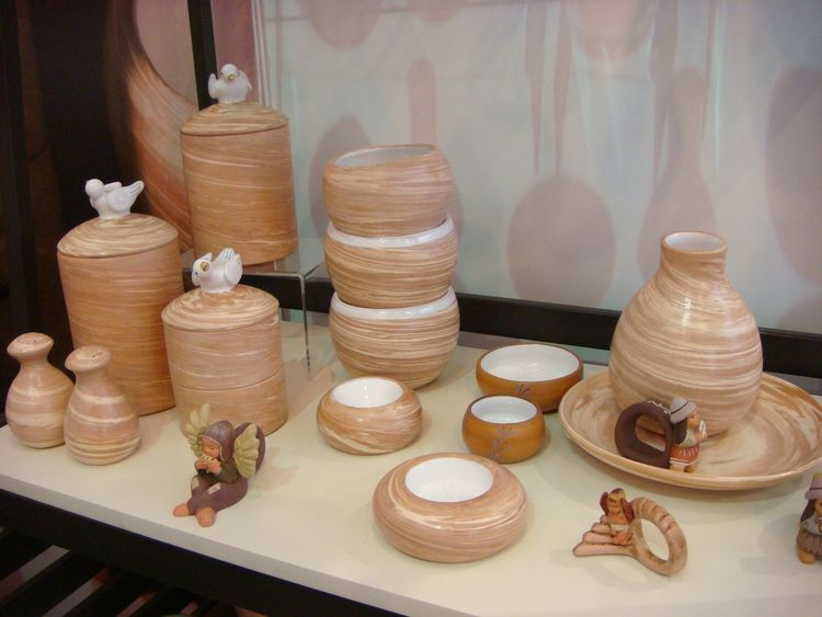 "These handmade ceramics derive their color from natural red and white clays mixed together on a potter's wheel and are fabricated by the <a href=""http://www.perwaq.com/"">TAWAQ</a> association of artisans."