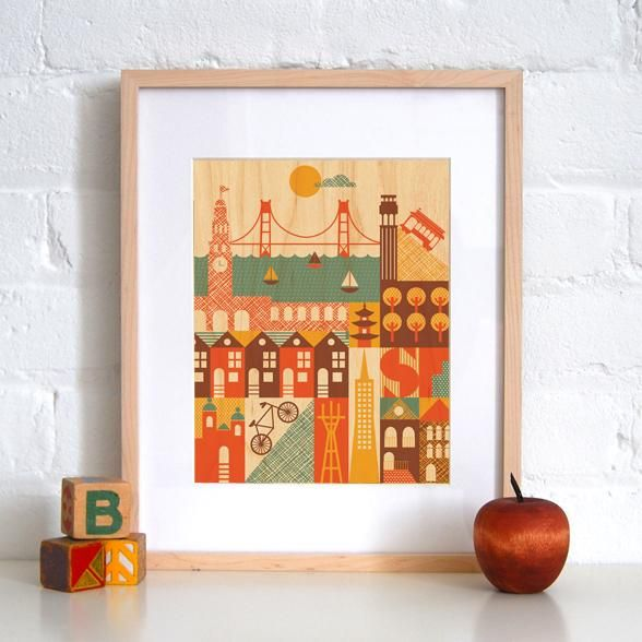 "This print of San Francisco landmarks on maple by <a href=""http://www.petitcollage.com/"">Petit Collage</a> also came home with me."