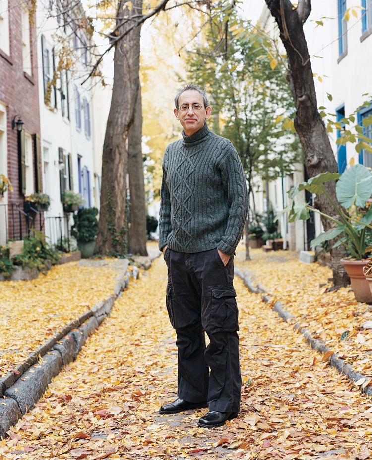 Ken Kalfus stands amidst the autumn leaves.