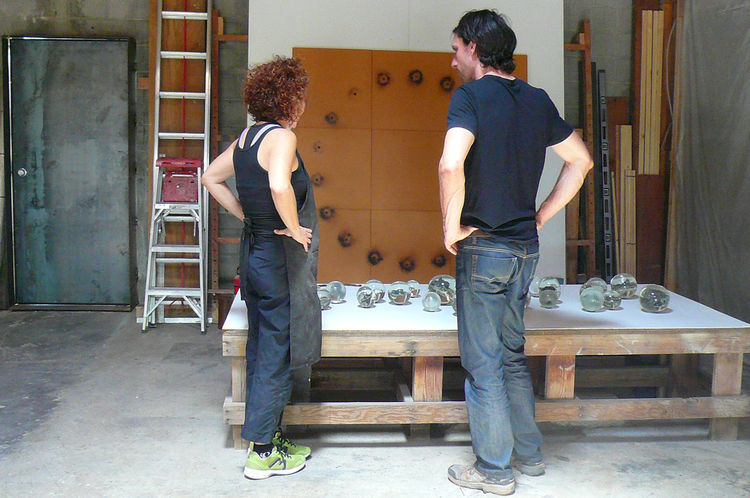 Here, Kratz and Keener discuss her recent experiments with glass, such as these globes that perfectly record the shape of the animal skulls and starfish embedded (and incinerated) within them.