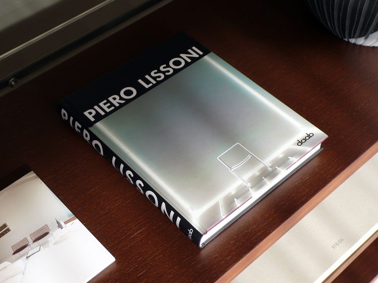 A book of Lissoni's designs from daab rests on a shelf in his System NXT.