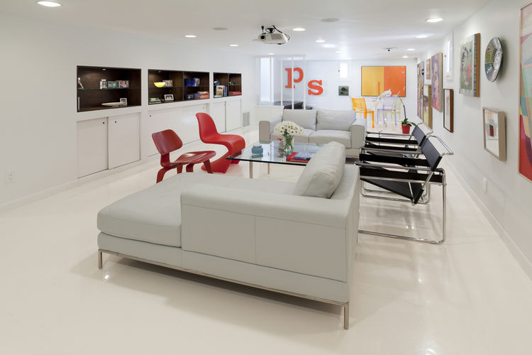 "The open media room. Joining the Panton and Eames chairs are leather-and-chrome Breuer chairs, a Mies Barcelona table and a chaise and loveseat from IKEA. Photo by <a href=""http://mikegraffigna.com/"">Mike Graffigna</a>"