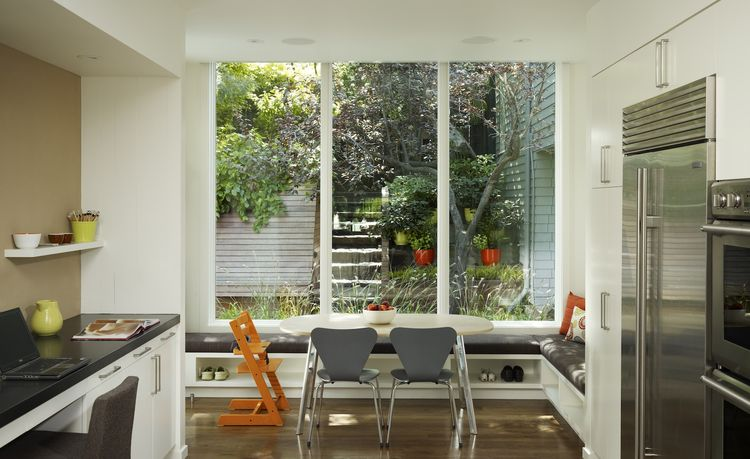 The modern breakfast area also serves as a mudroom with plenty of shoe storage under the window seat.