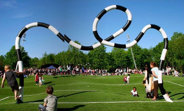 """Puckelball"" is a variant of soccer played on a field that looks like it was attacked by giant moles with a goal designed by the Mad Hatter. Its creator, artist Johan Strom, thinks of it as a metaphor for life:  ""Many live under the belief that life is a"