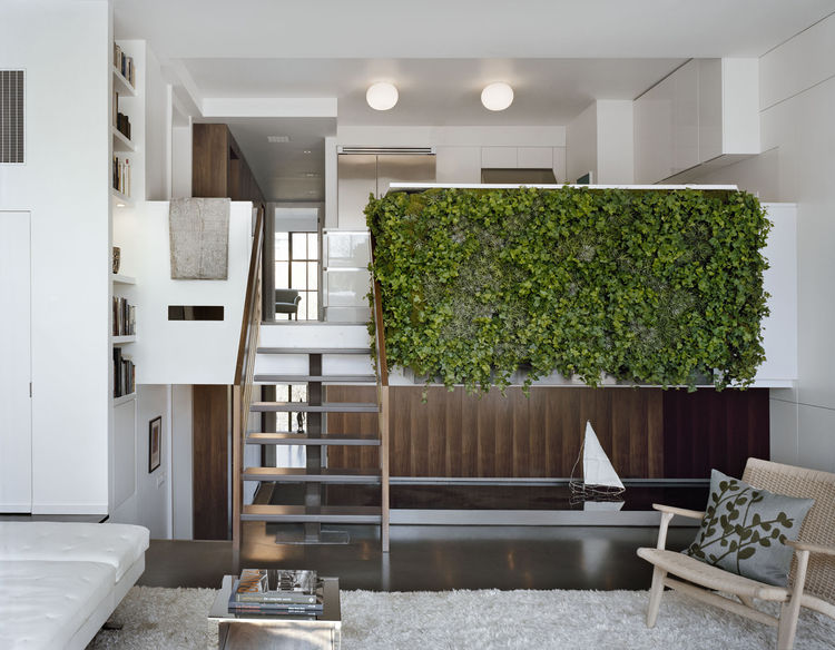 The completed garden wall and water trough frames the client's breakfast area and walnut-paneled study. Photo by Elizabeth Felicella.