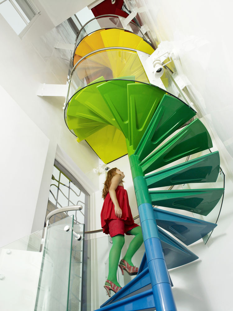 """""""The staircase is the hub, the soul of the project,"""" Rogers says. """"It's meant to be enjoyed."""" From the ground, the steps start with the cool colors of the earth, then get warmer as they reach up to the sky."""