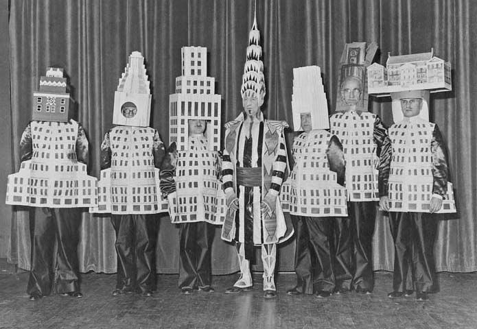 1931 Beaux-Arts Ball at the Hotel Astor. (L-R) A. Stewart Walker as the Fuller Building, Leonard Schultze as the Waldorf-Astoria Hotel, Ely Jacques Kahn as the Squibb Building, William Van Alen as the Chrysler Building, Ralph Walker as the Irving Trust, D