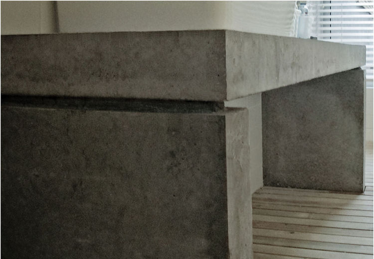 A closer look at the cast-in-place concrete counter in the master bathroom.
