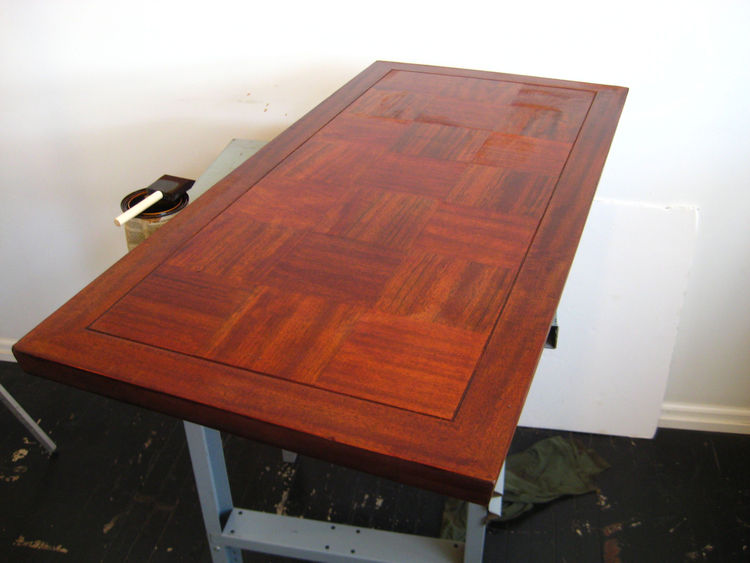 Back in my studio, I stain the table top with a red oak wood stain that's been sitting in someone's workshop since 1986. I get most of my wood refinishing materials from estate sales so I don't make $40 runs to the hardware store every time I want to work