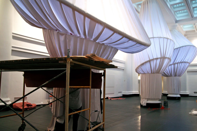 "Further, the team had the space in mind beyond the colonnade. ""We're always thinking that this is an environment, a setting for things to take place,"" says Luknayov. He notes that the installation allows room for performance space as well as sufficient an"