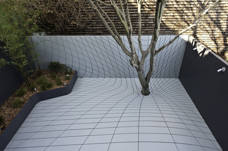 In lieu of a traditional backyard, Faulders Studio in San Francisco invented the Deformscape: an 'outdoor room' that's also an optical illusion: it looks like it dips around the tree but is actually a flat surface ideal for entertaining. Photo by Digited