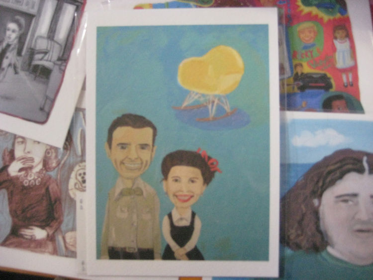 "It's blurry, but this is a cute print from <a href=""http://artbyel.com/"">El Lohse Illustration</a> of Charles, Ray, and an Eames Rocker. What a happy family!"