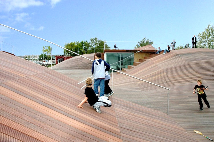 """A playscape doesn't have to be a separate plot of ground. <a href=""""http://jdsa.eu/"""">Julian de Smet Architects</a> turned the roof of a boat storage facility into a skating and sliding landscape for play.<br /><br />Image courtesy of <a href=""""http://jdsa.e"""