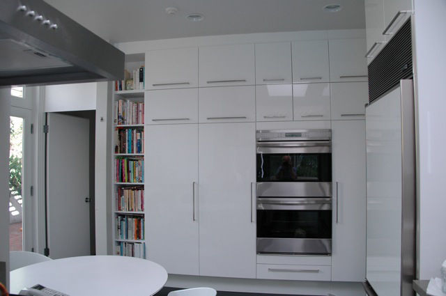 The remodeled cabinets reflect the same pattern as the old ones, though they are all new. By keeping the underlying design in mind, the new kitchen seems like it could have been from Dorman's original design.