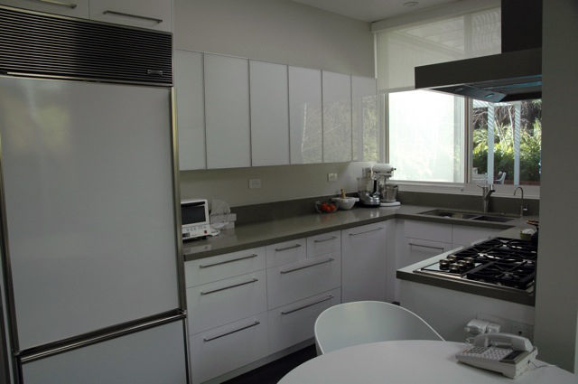 Here's the kitchen after it was gutted and received a much needed face lift. When remodeling the kitchen, Sallin can't stress how important it is to have excellent contractors and builders and a solid plan of action. Robert's nephew Marc Sallin of <a href