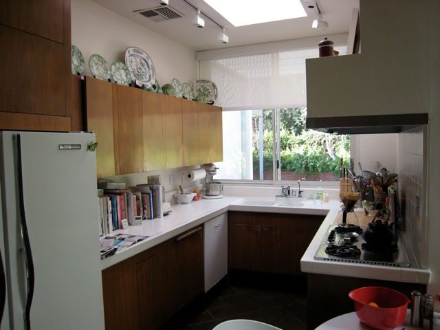 """The small galley kitchen was recently remodeled. """"I don't know how many different designs we looked at,"""" says Sallin, who considered many top-of-the-line kitchens from all the big names. """"They just didn't feel right so we went to the original Dorman plans"""