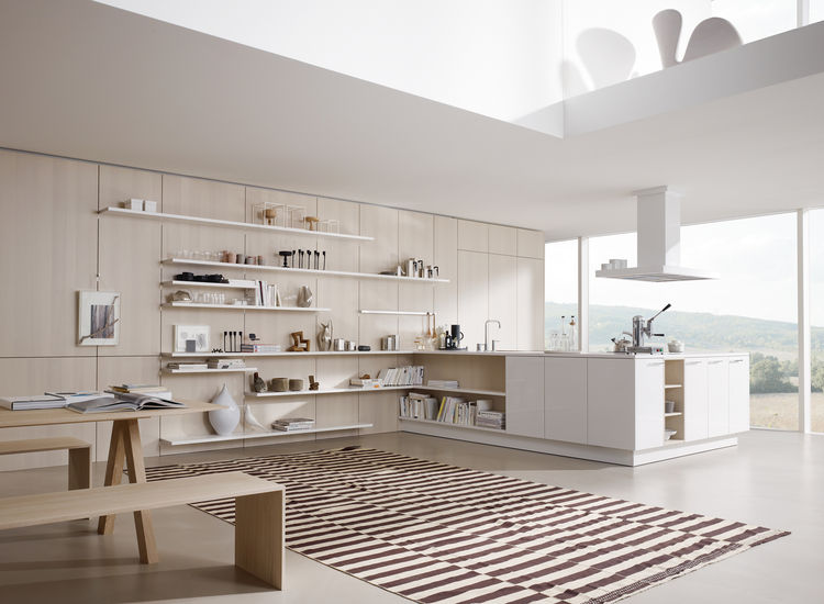 "This year's fair introduced a new interpretation of the Floating Spaces kitchen, meant for a large open plan. <a href=""http://www.siematic.com"">Siematic's</a> intention was a complete integration of the kitchen into the interior architecture. The newly de"