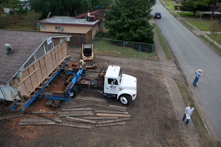 "Under the supervision of Cherry Structural Movers, the house glides out of the narrow lot. During the rotation, the action streamed <a href=""http://www.prototype180.com/"">live</a>; the site will continue to monitor the project's process."