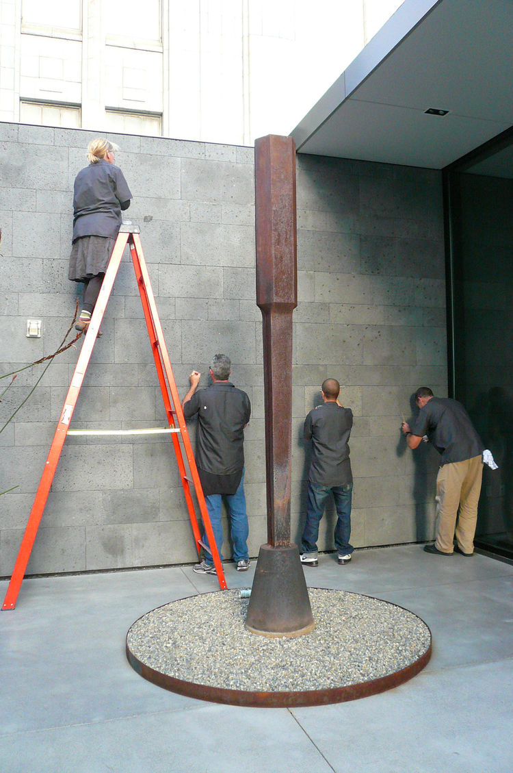 The crew hard at work, in the shadow of a sculpture.