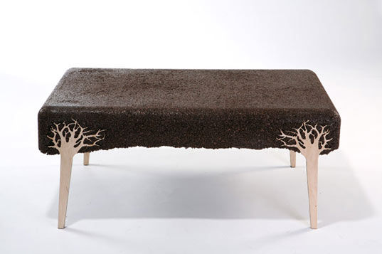 "Designed by <a href=""http://www.yoavavinoam.com/"">Yoav Avinoam</a> in 2009, this Shavings Table is made from a composite of mixed sawdust, leftover wood shavings, and resin, cast in an everyday plastic tub.  These unique tree-inspired legs are placed into"