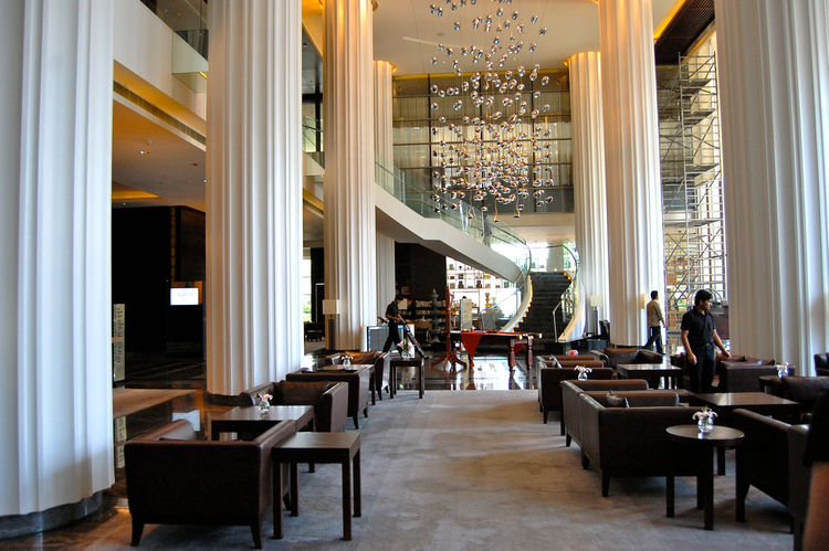 The grand lobby of the Marriott in Pune is in direct contrast to it's surroundings. It's one of many new luxury hotels popping up in the city, which is a growing tech hub.