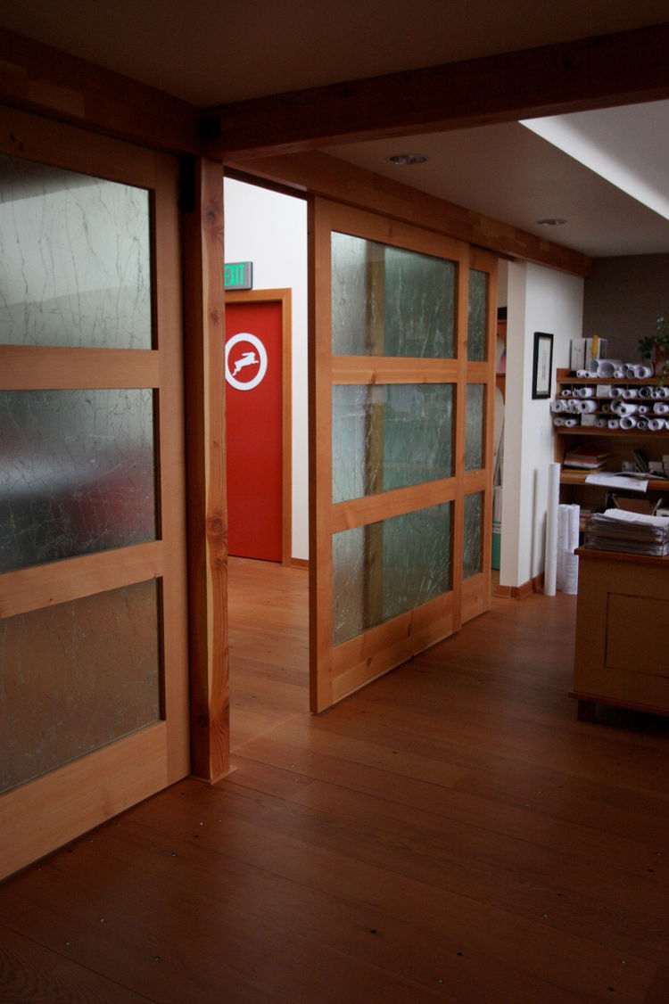 Upcycled Sliding Doors<br /><br /> Submitted by: Name not provided<br /><br /> Designer's Description: <br /><br />Constructed from reclaimed and recycled materials with an open floor plan that facilitates communication, the remodeled space embodies the f