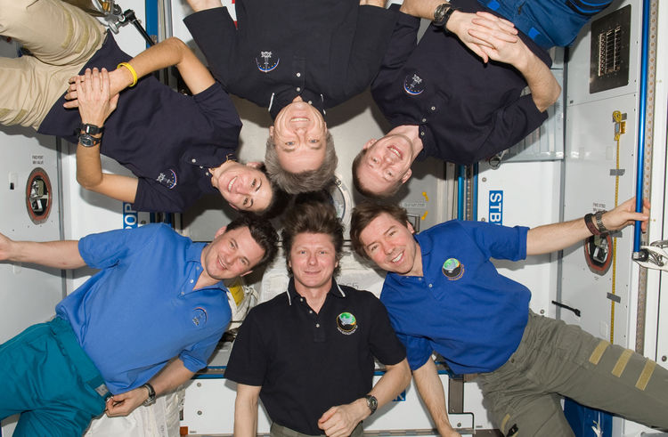 Expedition 20 crew members pose for an in-flight crew photo in the Harmony node of the ISS. Pictured clockwise are Russian cosmonaut Gennady Padalka (bottom center), commander; Russian cosmonaut Roman Romanenko, NASA astronaut Nicole Stott, Canadian Space